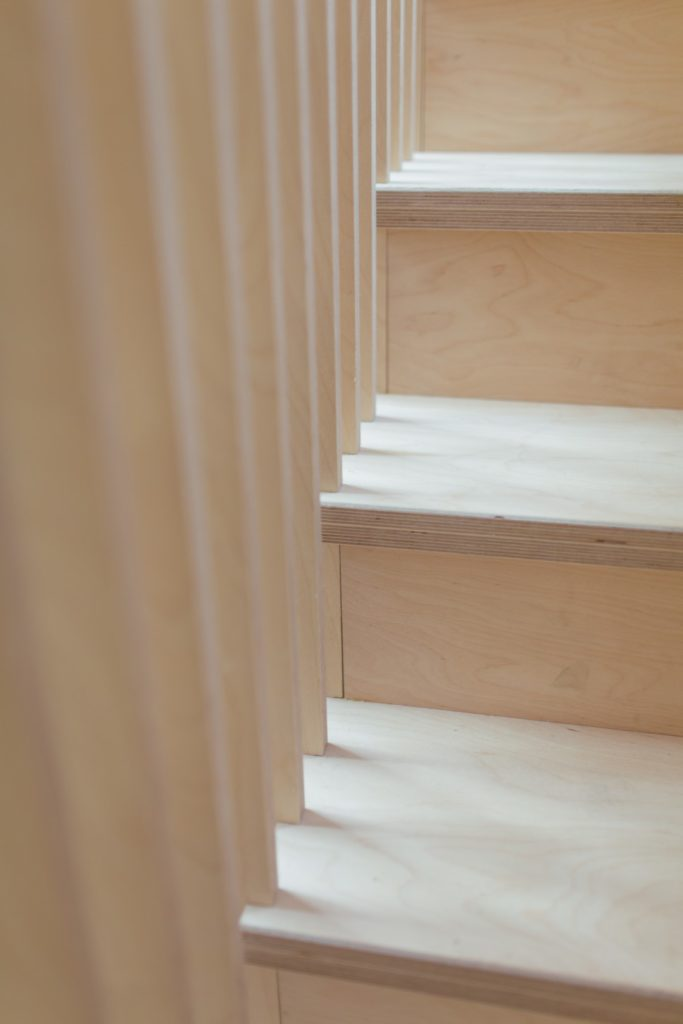 This is an interior staircase photograph of Box House. It is made of U-Build in collaboration with Studio Bark and has been featured on the Grand Designs TV show.