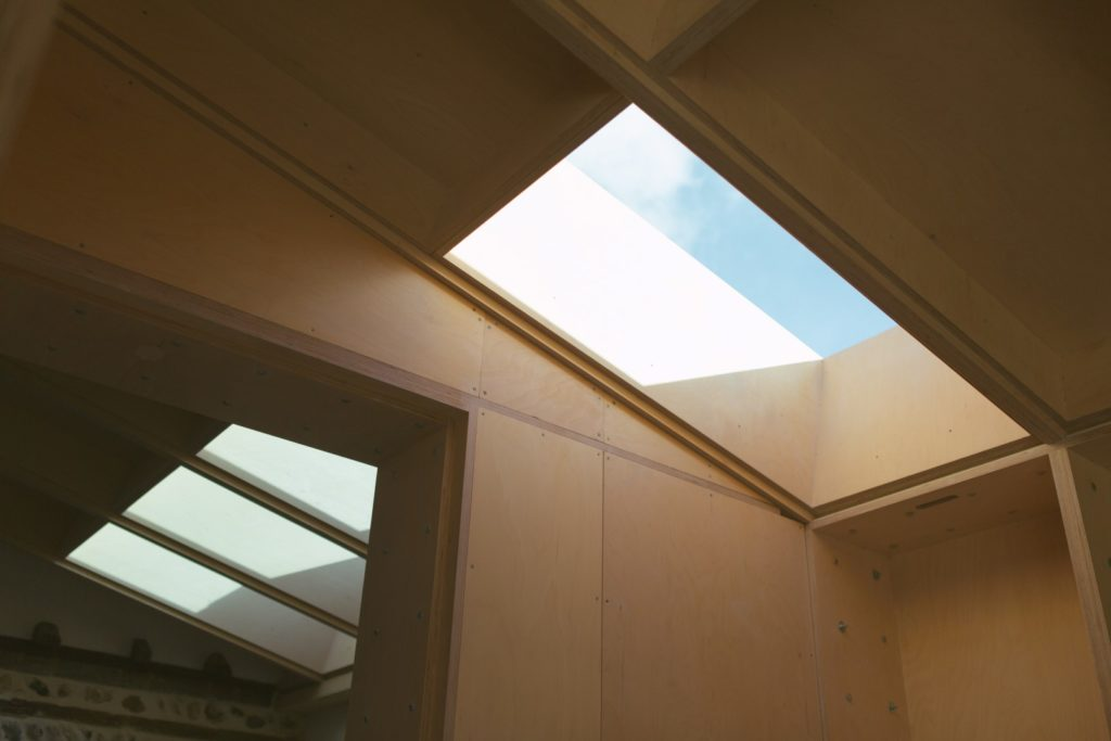 Bespoke wooden roof with skylight in a bespoke house